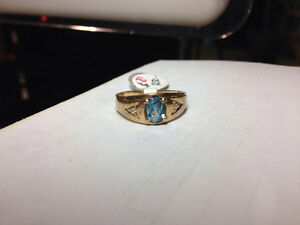 10k Gold Ring with Aquamarine stone $250