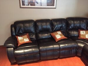 Selling black leather sofa! Great for families