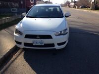 2011 white Mitsubishi Lancer 45000 km safetied and e tested
