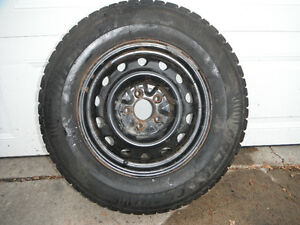 """Ford mounted 15"""" snow tires"""