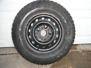"Ford mounted 15"" snow tires"