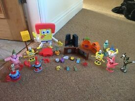 Bundle of spongebob figures and mini play sets never played with