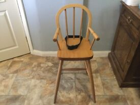Tall child's high chair with safety strap