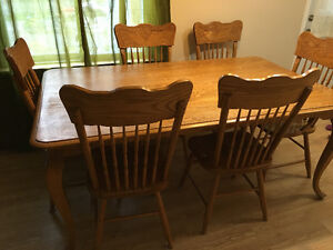 Oak table all one solid piece with 6 matching chairs