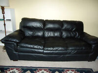 Clean black leather couch