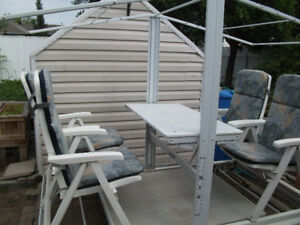 White glider swing with table. Chairs recline,  Reduced to $775