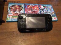 Wii u with 3 games (1 still sealed)