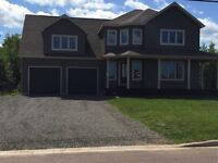 A MUST SEE! Custom two-story home on Amiens Dr (North End)