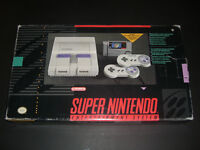 Super Nintendo (SNES) in box with 2 controllers and SMW