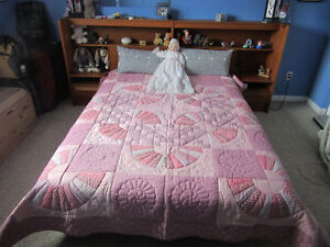 Queen size hand-stitched quilt