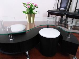 Brand new glass coffee table with 2 small ottomon.