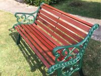 Quality African sapele hardwood garden bench with cast iron ends.
