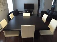 Extendable Wood table with 6 leather chairs
