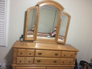 Oak dresser with mirror, side table, and headboard for queen