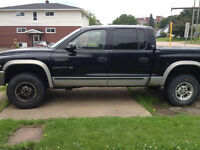 "2000 Dodge Dakota Black and silver Pickup Truck. """"New Price"""""