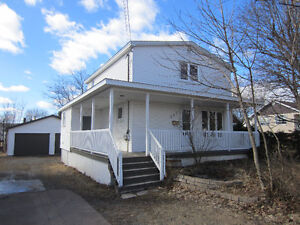 Two storey home with private backyard and large garage