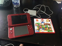 $200.00 NEW NINTENDO 3DS XL - Barley used with charger and game