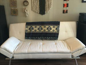 Chic White Leather Coach bed.