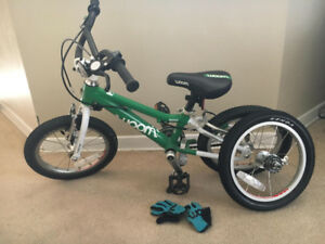 Woom 2 14 inch bike with gloves and spare tire