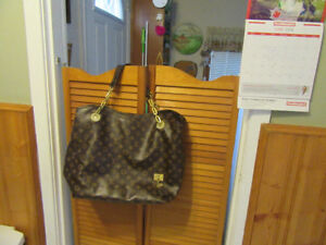 "Louis Vuitton  large 14"" long 20""wide  new condition."