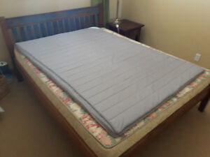 Queen size bed with mattress and mattress cushion