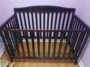 Brown crib and 2 different blanket sets
