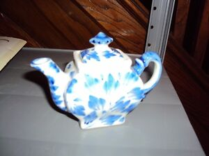 Tiny blue and white china teapot, great for child's play