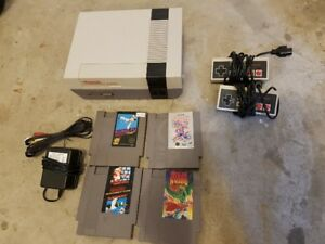 Nintendo NES + 4 games, 2 controllers and all hook ups