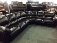 As new large soft black leather corner sofa