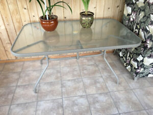 Patio table and 6 padded chairs