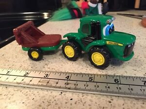 Ertl John Deere with eyes die cast tractor and trailer