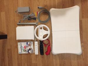 Nintendo Wii + Mario Kart+ 2 controllers + steering wheel+ more!