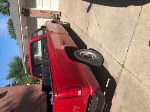1990 red Chevy 1/2 ton 2door 8' bed