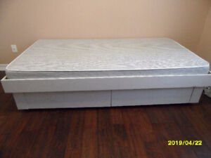 Bed with mattress and pull out drawers