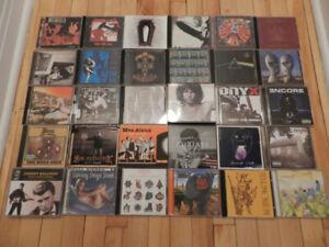 Albums de rock et de rap à 5$ ch.
