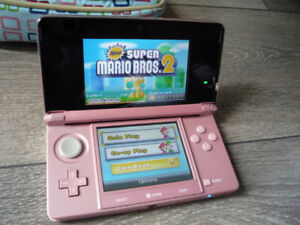 Pink Nintendo 3DS console with 7 games