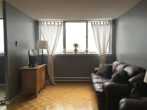 Room for Rent in Large Top Floor 2-Bedroom Apt. (May 1st) FEMALE