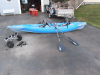 Pelican model Apex 13ft Sit-in Kayak with canoe carrier wheels