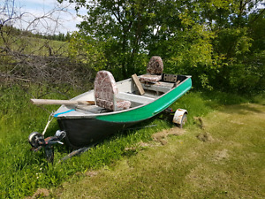 12 ft aluminum boat with trailer.