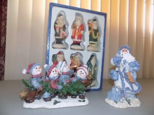 Christmas hand painted Santas and two other figurines.