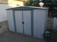Free 6 Foot by 7 foot tin shed.