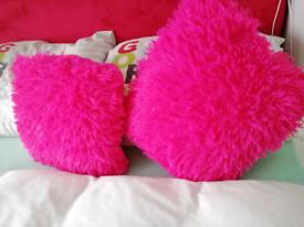 Pink fluffy cushions.