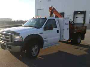 Ford F550 picker flat deck with winch line