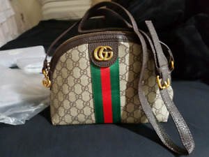 Gucci small purse with long strap..