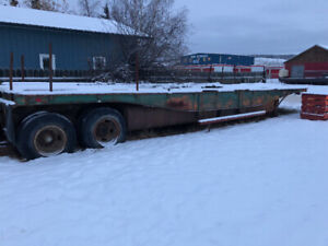 High boy trailer with  two 1100 gallon belly fuel tanks