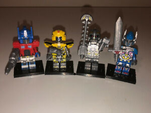 Brand New!! All 4 TRANSFORMERS Lego Men - For Only $5 Total