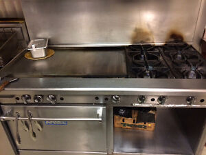 Restaurant gas range with grill and deep fryers