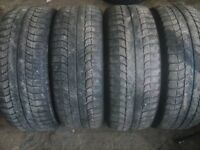 Four Michelin 215 55 17 winter tires.