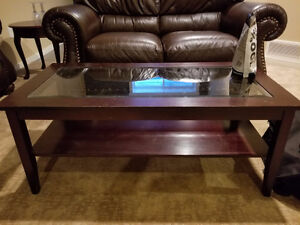Dark brown wood coffee table for sale!Some scratches on the glas