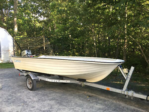 14 foot fibreglass boat with trailer and 15 hp Honda motor